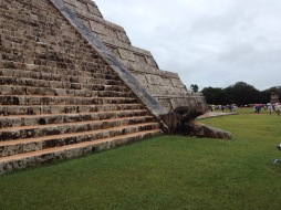 A snake's head lies at the feet of the Kukulcan Temple, Chichén Itzá.